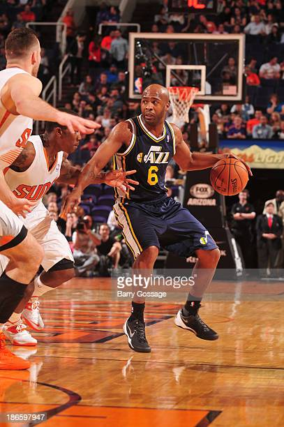 Jamaal Tinsley of the Utah Jazz handles the ball against the Phoenix Suns on November 1 2013 at US Airways Center in Phoenix Arizona NOTE TO USER...