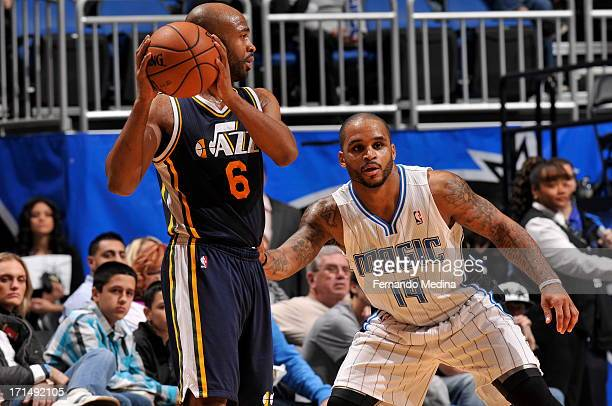 Jamaal Tinsley of the Utah Jazz looks to pass against Jameer Nelson of the Orlando Magic on December 23 2012 at Amway Center in Orlando Florida NOTE...