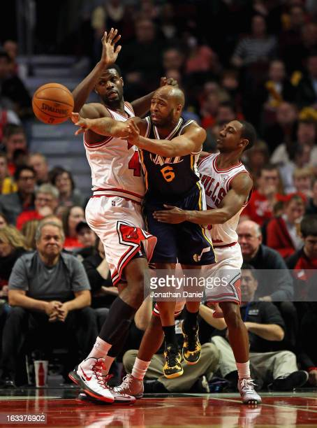 Jamaal Tinsley of the Utah Jazz passes between Nazr Mohammed and Marquis Teague of the Chicago Bulls at the United Center on March 8 2013 in Chicago...
