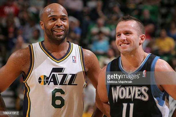 Jamaal Tinsley of the Utah Jazz shares a word with Jose Barea of the Minnesota Timberwolves during the game at Energy Solutions Arena on April 12...