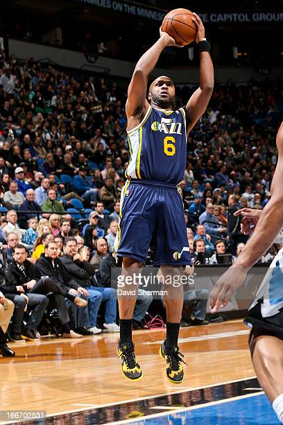 Jamaal Tinsley of the Utah Jazz shoots against the Minnesota Timberwolves on April 15 2013 at Target Center in Minneapolis Minnesota NOTE TO USER...