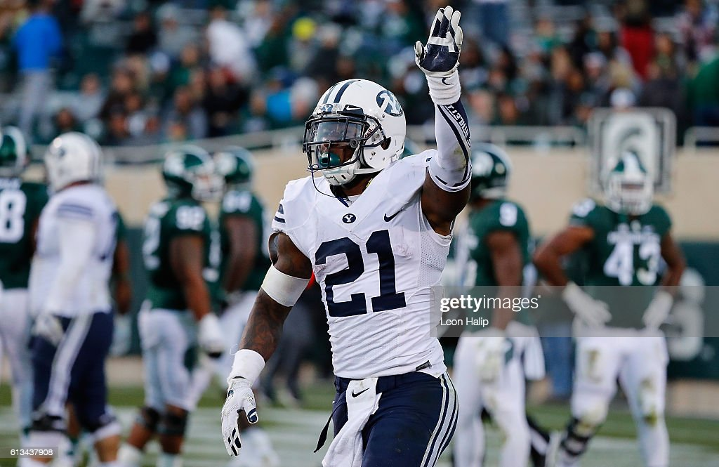 Jamaal Williams #21 of the Brigham Young Cougars celebrates a win over the Michigan State Spartans at Spartan Stadium on October 8, 2016 in East Lansing, Michigan. Brigham Young defeated Michigan State 31-14.