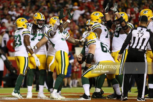 Jamaal Williams of the Green Bay Packers celebrates with teammates after a oneyard rushing touchdown against the Kansas City Chiefs in the first...