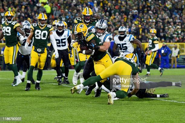 Jamaal Williams of the Green Bay Packers gets tackled by Luke Kuechly of the Carolina Panthers in the game at Lambeau Field on November 10 2019 in...