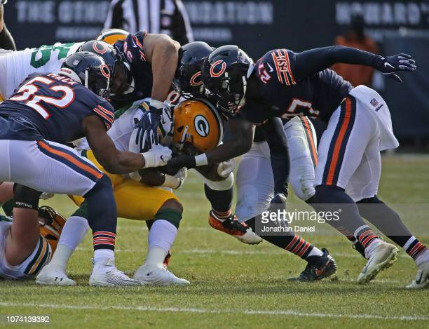 Jamaal Williams of the Green Bay Packers is gang-tackled by Kahlil Mack, Akiem Hicks, Roquan Smith and Sherrick McManis of the Chicago Bears at...