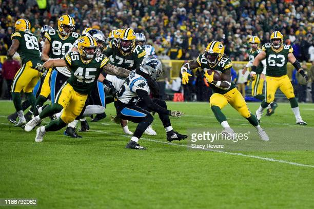 Jamaal Williams of the Green Bay Packers runs the ball against the Carolina Panthers during the second quarter in the game at Lambeau Field on...