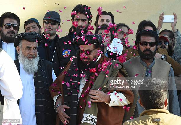 Jamaat ud Dawa chief Hafiz Saeed gestures as he arrives to attend a protest in Quetta on December 21 against alleged activities by neighbouring India...
