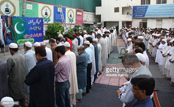 Jamaate Islami Party members hold a funeral prayer absentia for JamaateIslami leader Mir Quasem Ali who was executed in Karachi Pakistan on September...