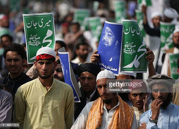 JamaateIslami supporters stage a protest against the execution of Mumtaz Qadri former police bodyguard who shot dead Punjab's governor Salman Taseer...