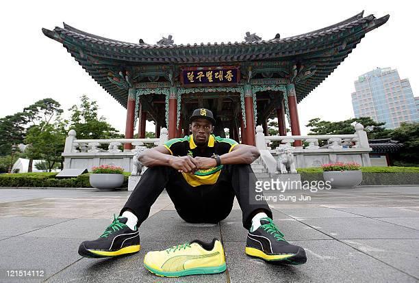 Jamacian sprinter Usain Bolt poses at the Daegu Bell prior to the lAAF World Athletics Championships, on August 20, 2011 in Daegu, South Korea.