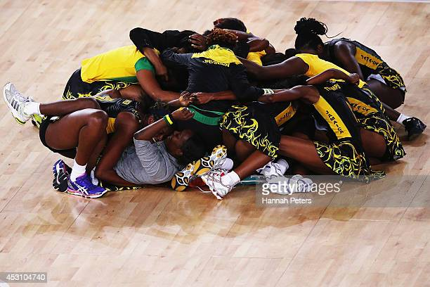 Jamaica celebrate after winning the bronze medal match between England and Jamaica at SECC Precinct during day eleven of the Glasgow 2014...
