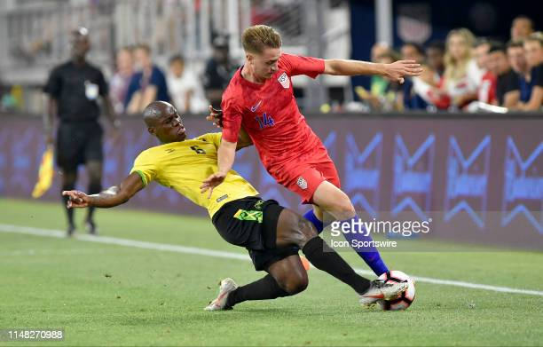 Jamaica forward Dever Orgill slide tackles United States midfielder Djordje Mihailovic during the United States Mens National Team international...