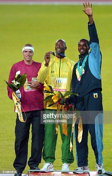 Jamaica gold medalist Michael Blackwood , Canadian silver medalist Shane Niemi and bronze medalist Avard Moncur pose on the podium after the 2002...