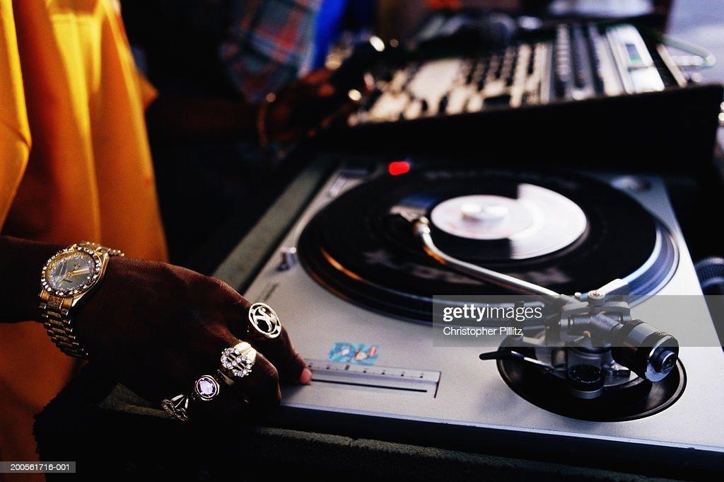 Jamaica, Kingston city, male DJ playing music, close-up of hand : Foto de stock