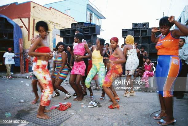 Jamaica, Kingston, group of people dancing in street, blurred motion