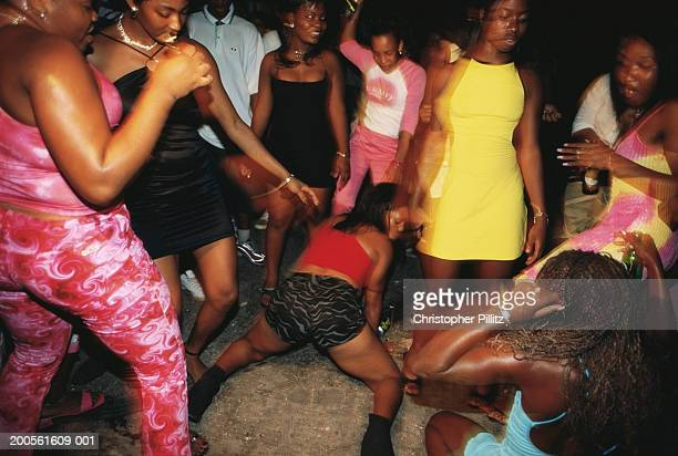Jamaica, Kingston, people dancing at street, night, burred motion