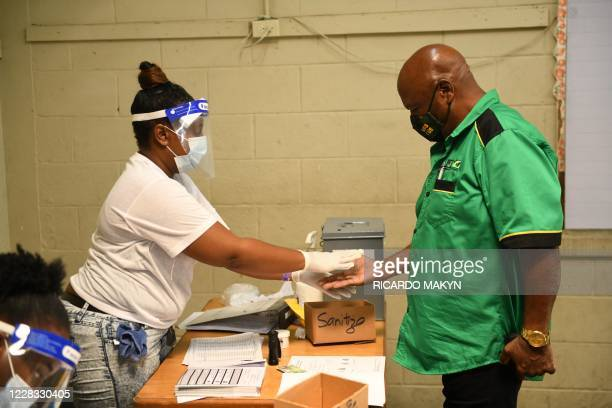 Jamaica Labour Partys Newton Amos is seen at the Mount Rosser Primary and infant school where he cast his ballot in the St. Catherine north west...