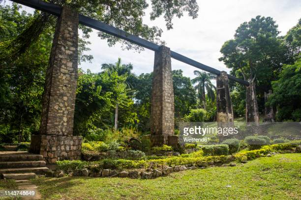 jamaica, montego bay, old sugar mill waterpipe - montego bay stock pictures, royalty-free photos & images