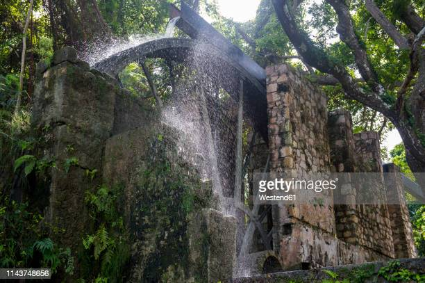jamaica, montego bay, old sugar mill waterwheel - montego bay stock pictures, royalty-free photos & images