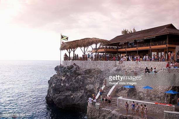 jamaica, negril, people at clifftop cafe, sunset - jamaica stockfoto's en -beelden
