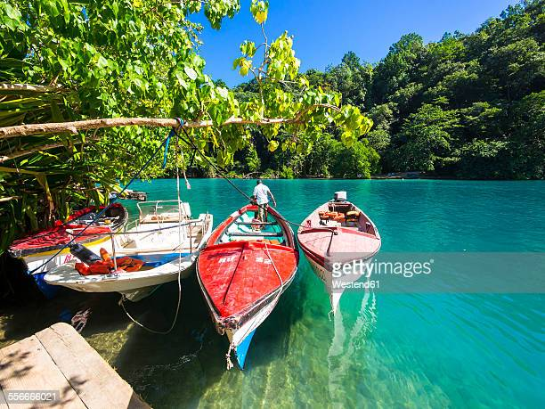 jamaica, port antonio, boats in the blue lagoon - jamaica stock pictures, royalty-free photos & images