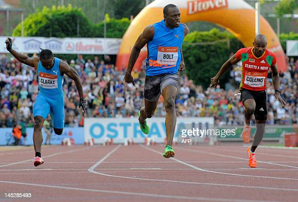 Jamaica sprinter Usain Bolt crosses the finish line ahead of Lerone Clarke of Jamaica and Kim Collins of Saint Kitts and Nevis during the men's 100m...