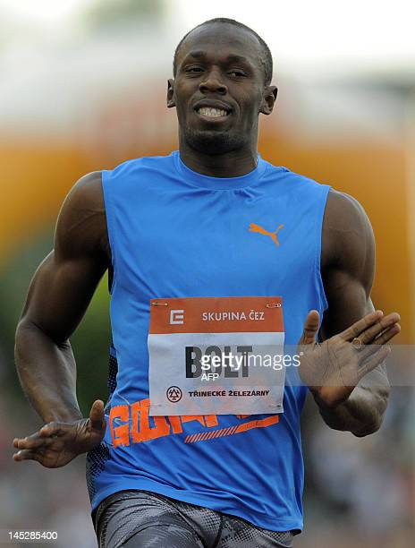 Jamaica sprinter Usain Bolt reacts as he crosses the finish line and won the men's 100m race of the Zlata Tretra athletics meeting in the eastern...