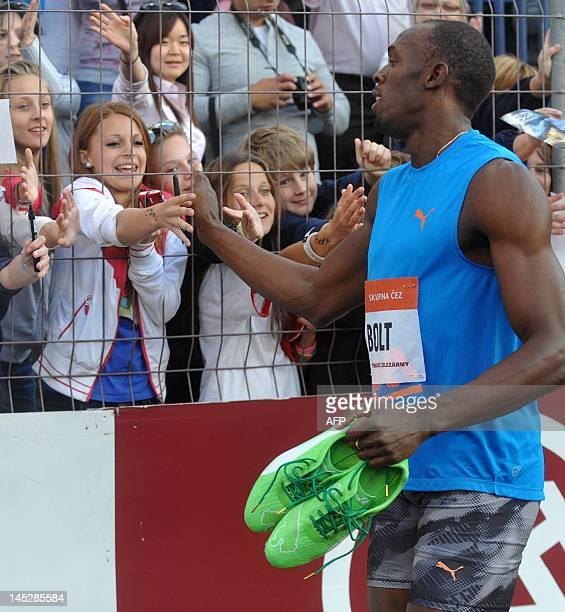 Jamaica sprinter Usain Bolt salutes supporters after winning the men's 100m race of the Zlata Tretra athletics meeting in the eastern Czech city of...