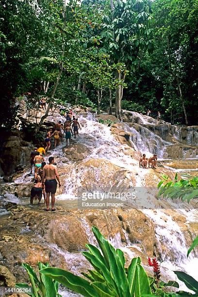 Jamaica Tourists Climbing Dunns River Falls