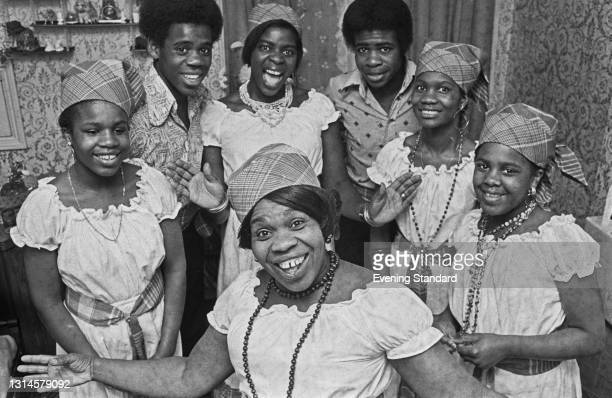 Jamaica-born community leader Gloria Cameron with her six children, London, UK, 6th November 1973. That year, she became one of the first Black women...