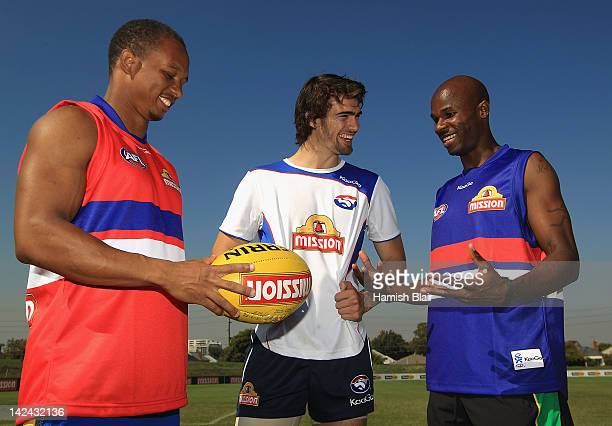 Jamaican 4 x 100m relay world record holder Michael Frater and Saint Kitts and Nevis sprinter Kim Collins meet with Western Bulldogs' AFL player...
