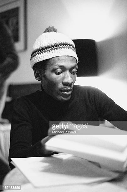 Jamaican actor reggae singer and songwriter Jimmy Cliff signing a record contract with WEA records London 2nd February 1973