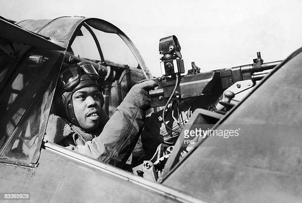 Jamaican air gunner of the RAF in the cockpit of an Army Co-operation Command aircraft, circa 1940.