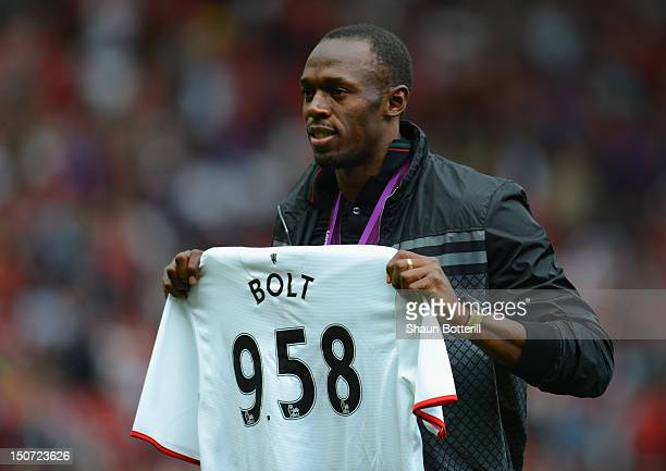 Jamaican Athlete Usain Bolt poses with a United shirt prior to the Barclays Premier League match between Manchester United and Fulham at Old Trafford...