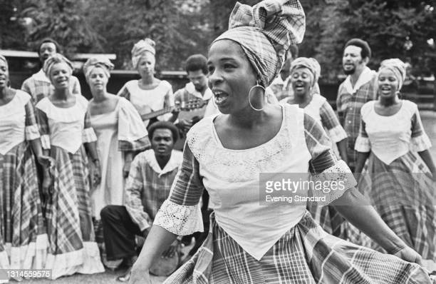 Jamaican author and musicologist Dr Olive Lewin performing with the Jamaican Folk Singers outside the Commonwealth Institute in Kensington, London,...