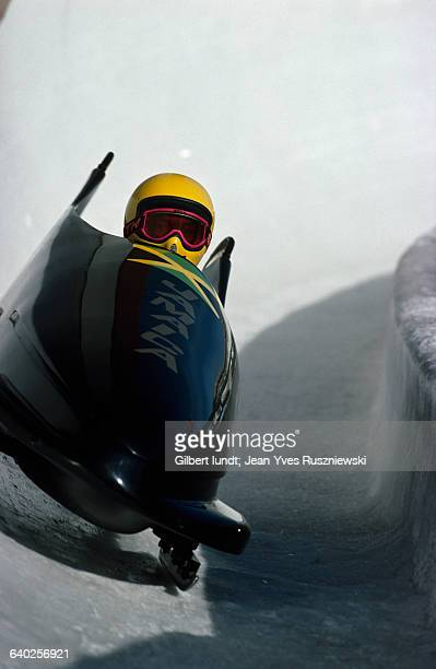 Jamaican bobsledding team on a curve during the 1988 Winter Olympics