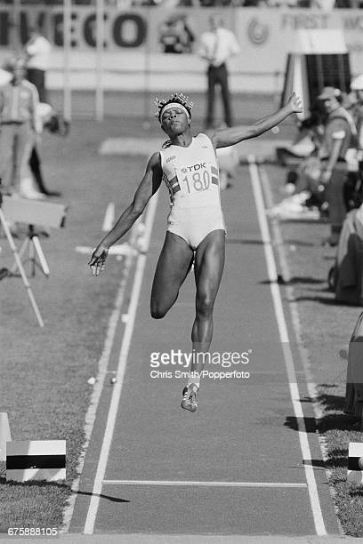 Jamaican born British heptathlete Judy Simpson competes in the long jump discipline on day 2 of the women's heptathlon event at the 1983 World...