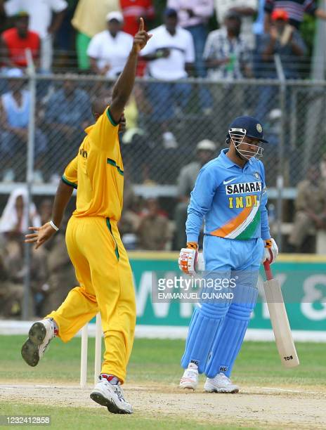 Jamaican bowler Darren Powell celebrates after dismissing Indian batsman Virender Sehwag during their one day international warmup match in Montego...