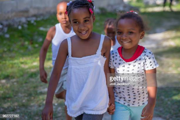 Jamaican children playing outside in poor village