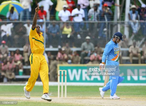 Jamaican cricket bowler Darren Powell celebrates after dismissing Indian batsman Virender Sehwag during their one day international warmup match in...