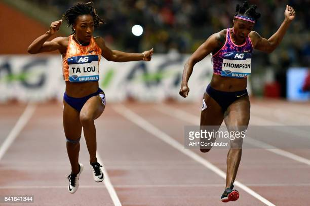 Jamaican Elaine Thompson crosses the finish line ahead of Ivory Coast Marie-josee Ta Lou at the end of the women's 100m race during the AG Insurance...