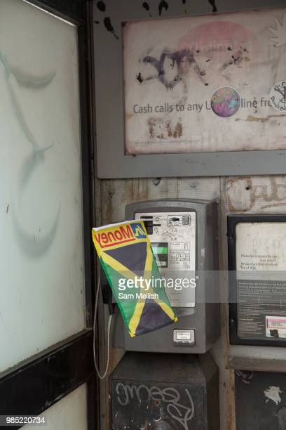 A Jamaican flag in a phone box during the Windrush70 celebration on the 23rd June 2018 in Brixton in the United Kingdom