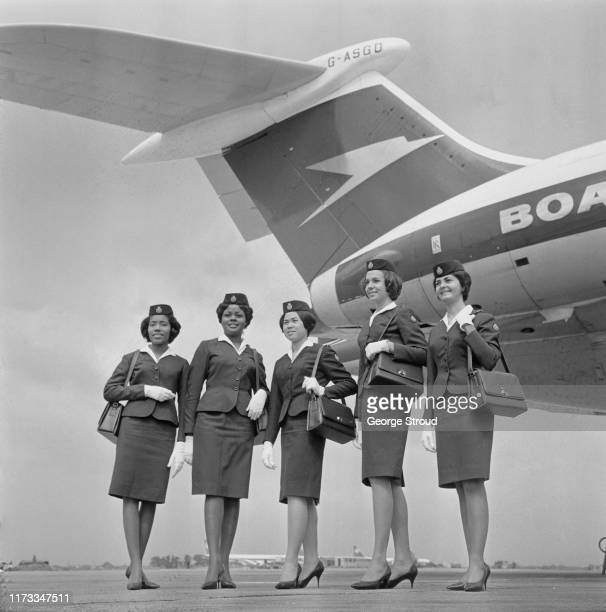 Jamaican flight attendants Claire Hendricks Yvonne White Camilla Woo Nancy Randall SallyKay McIver Thelwell stand near a British Overseas Airways...