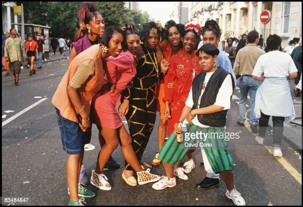 Jamaican girls pose for a photo at the Notting Hill Carnival in 1997 in London England
