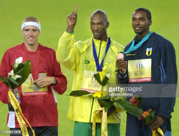 Jamaican gold medalist Michael Blackwood , Canadian silver medalist Shane Niemi and bronze medalist Avard Moncur pose on the podium after the 2002...