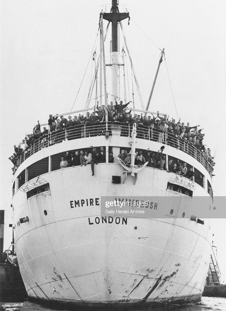 Jamaican immigrants arriving at Tibury Docks in Essex, 22 June 1948.'The former troop ship 'Empire Windrush' arrived at Tilbury Docks this morning with 450 Jamaicans, mostly Royal Air Force ex-servicemen, aboard. They have come to Britain to escape their island's unemployment problem. Until they are absorbed into British industry, some of the men will be accomodated at the Colonial Hostel in Wimpole Street in London, whilst others will be staying in the deep air raid shelters on Clapham Common. Some of the immigrants on board the Empire Windrush.' Photograph by Jones.