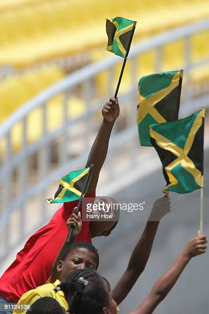 Jamaican kids hold up flags during day one of the tour match between Jamaica Select 11 and Australia at Trelawny Stadium on May 16 2008 in Trelawny...