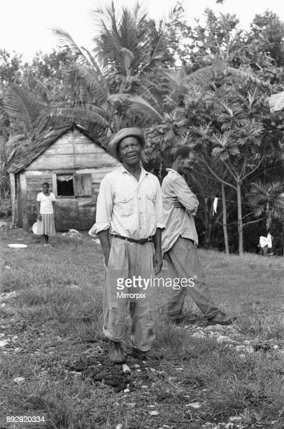 Jamaican Maroons pose for the camera outside their house in St Elizabeth The Maroons are descendants of escaped slaves who established free...