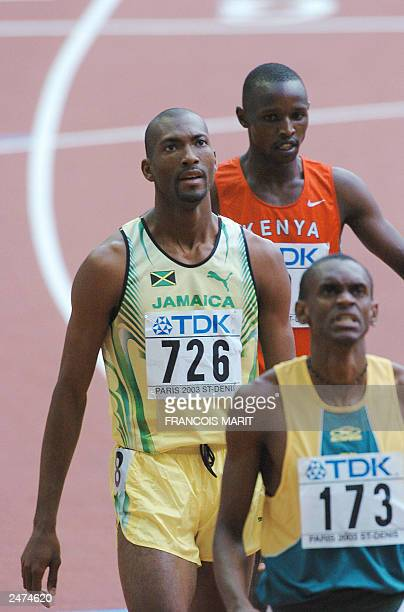 Jamaican Michael Blackwood looks at the results board after winning heat one of the mens 400m, ahead of Brazilian Anders Oliveira Dos Santos and...