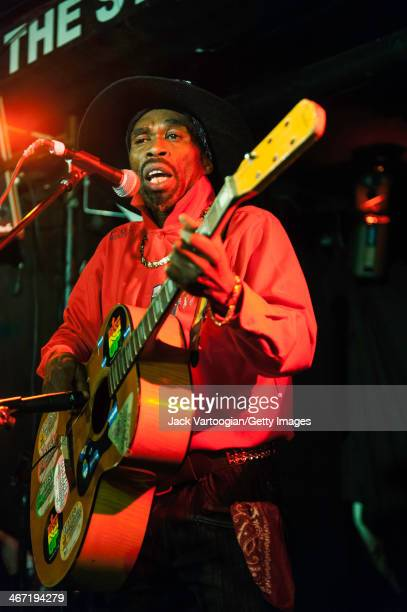 Jamaican musician Brushy OneString performs on his onestring guitar at Webster Hall's Studio Room Stage during GlobalFest 11 New York New York...